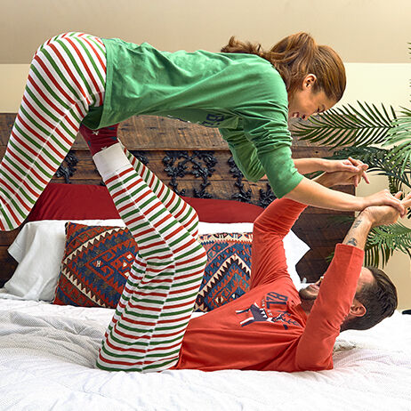 Man and woman playing in life is good pajamas